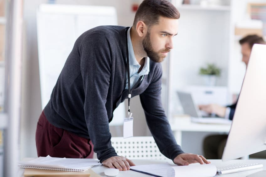 Nervous Businessman using Computer